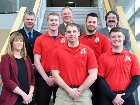 Wausau Area Law Enforcement Academy Graduates stand with their instructors on a staircase