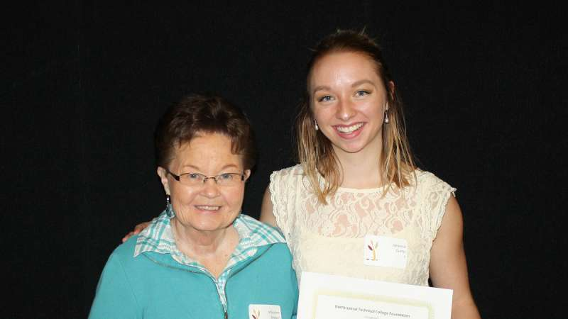 A student receives the Beth Ferrel Memorial Scholarship