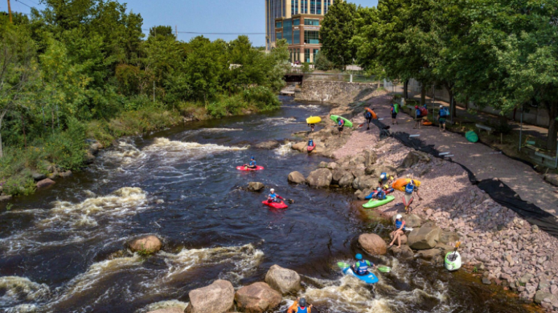 An aerial photo of downtown Wausau kayakers, shot by a camera mounted to a drone.