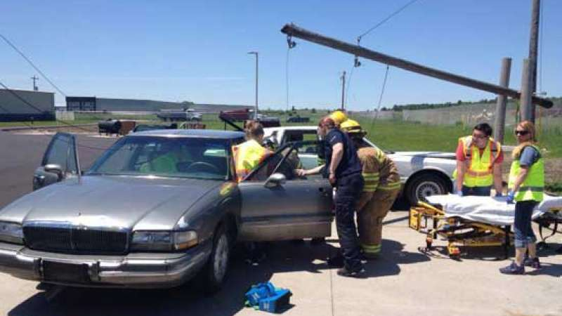 Several EMS workers training in a car with downed power lines scenario.