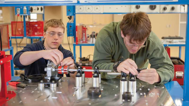 Two Electrical & Instrumentation Apprenticeship students sit together working on a project