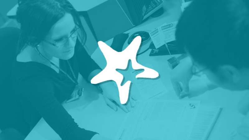 Starfish logo overlayed on top of student getting help from a student services employee